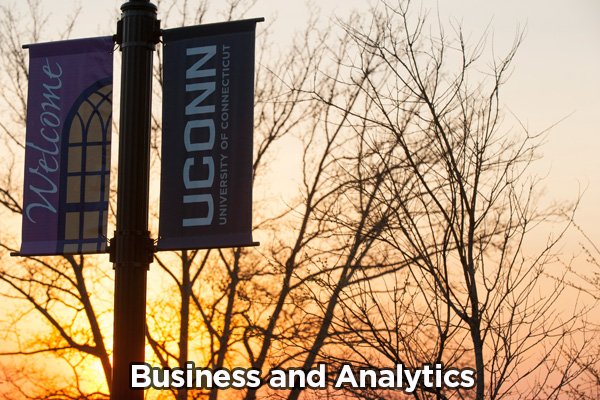UConn Signs with sunset background